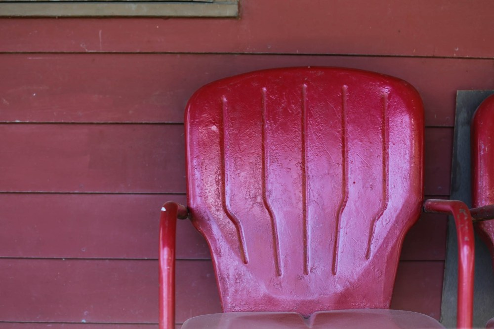 Red chair on red wall.