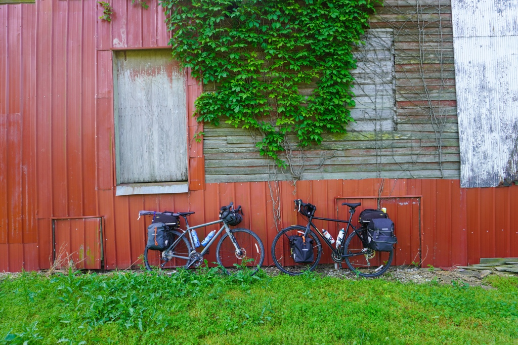 Old building along the Katy Trail with two bikes parked against it.