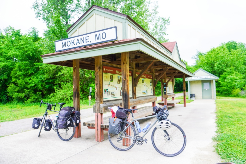 Two bikes leaning against the Mokan, MO trail depot.